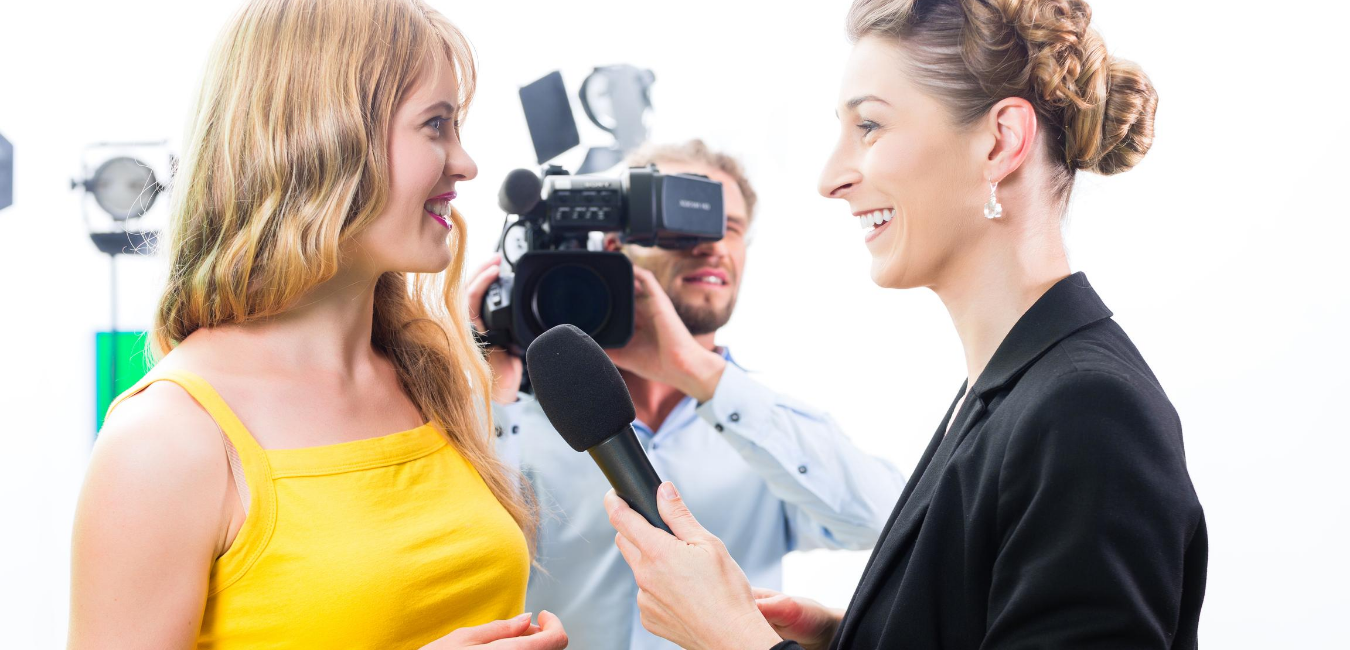 Woman interviewing woman for live TV